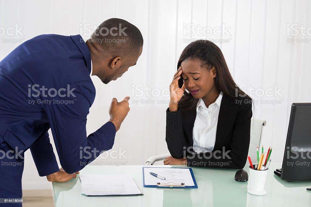 Boss Blaming Female Executive stock photo