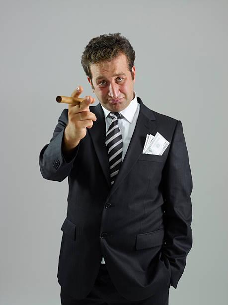 boss calling - guy with cigar stockfoto's en -beelden