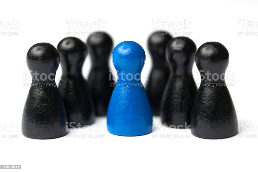 Boss, chief or team leader standing in the middle of his team. Business concept for leadership, teamwork or groups. Isolated on white background. stock photo