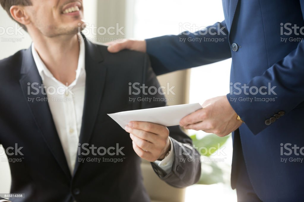 Boss congratulating employee with getting reward stock photo