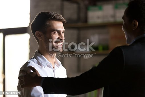 istock Boss congratulating employee with job promotion and good work results 1152268869