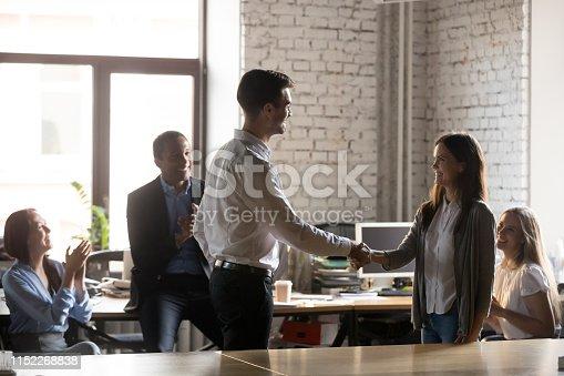 istock Boss congratulating female employee congratulating with promotion 1152268838