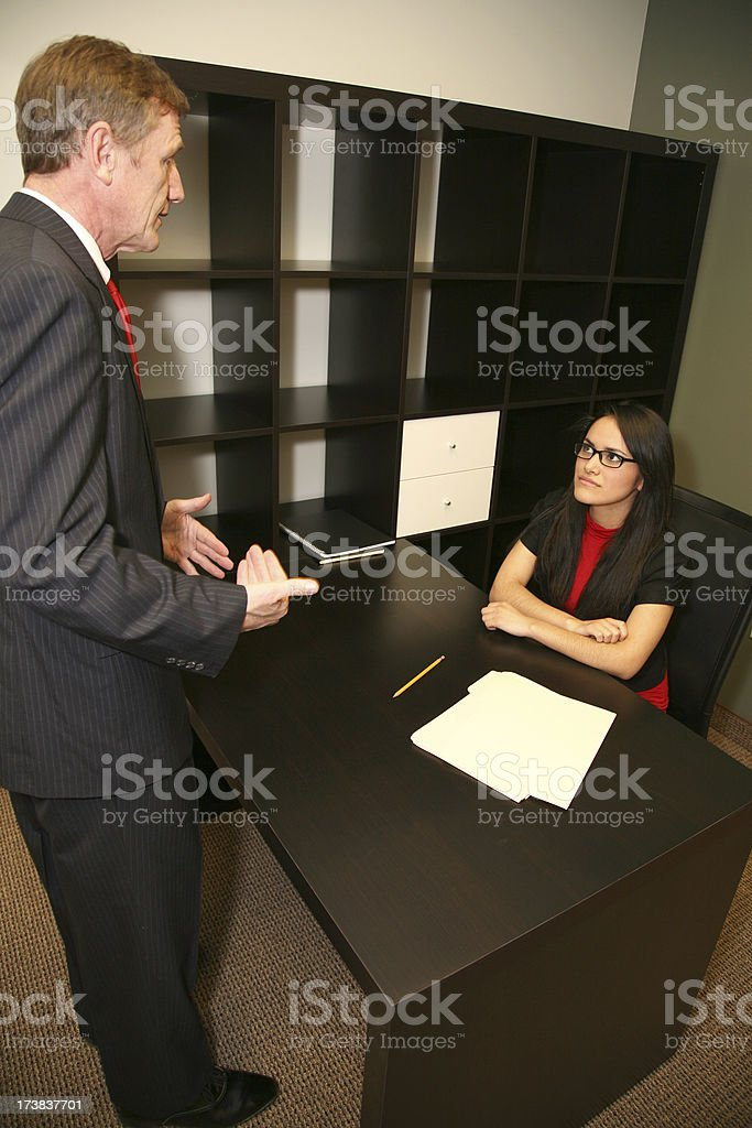 Boss Explaining Something to her female office worker royalty-free stock photo