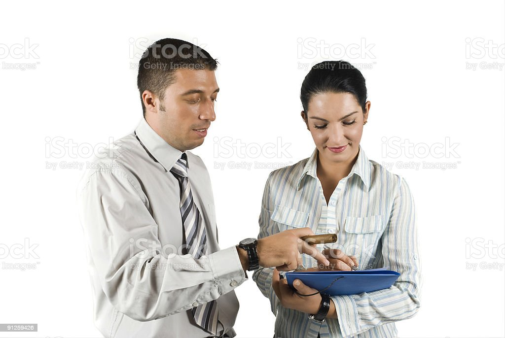 Boss giving a note to his secretary stock photo