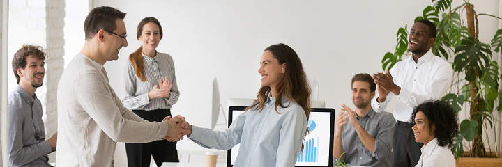 istock Boss handshaking with mixed race female employee congratulating with success 1134312244