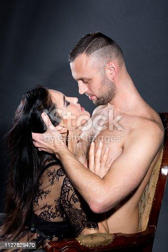istock Boss hugs with sweet housemaid 1127829470