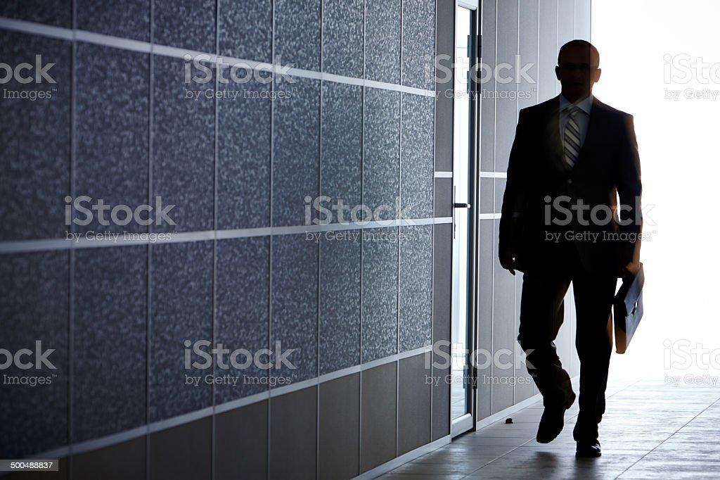 Boss in corridor stock photo