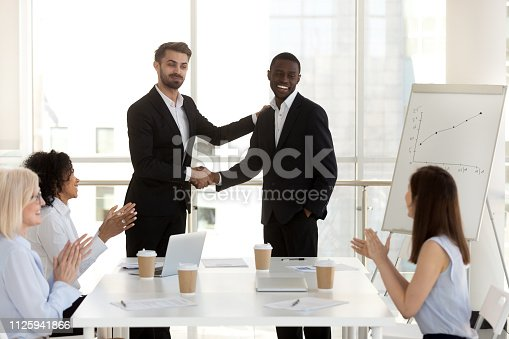 509032417 istock photo Boss introduce new black employee to colleagues 1125941866