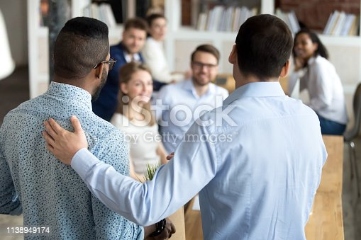 istock Boss introducing black new worker to workmates 1138949174