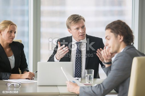istock Boss nagging and dismissing intern 628480368
