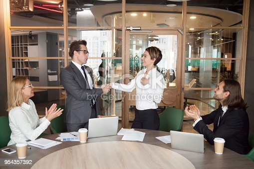 istock Boss promoting or introducing pleased businesswoman showing respect by handshake 954357392