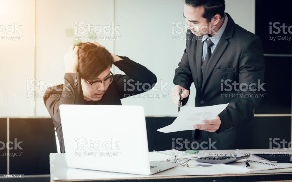 Boss reprimanding an employee in an office stock photo