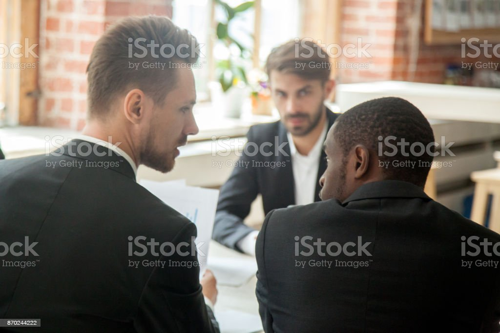 Boss scolding african-american employee because of unproductive results. stock photo