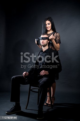 istock boss seating on chair blindfold 1127829144