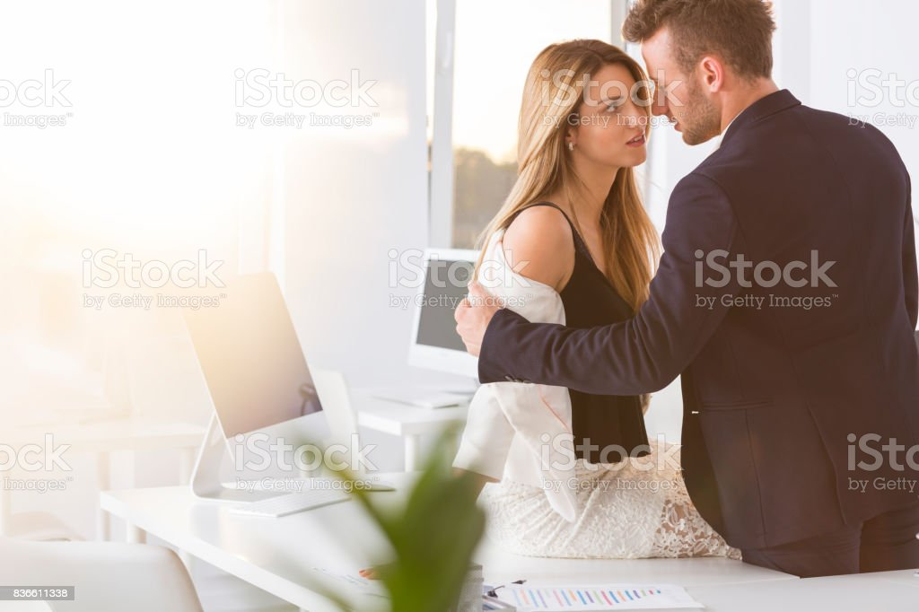 Boss undressing woman stock photo