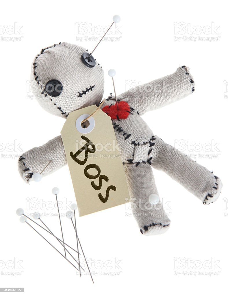 Boss Voodoo Doll Getting Pinned on White stock photo