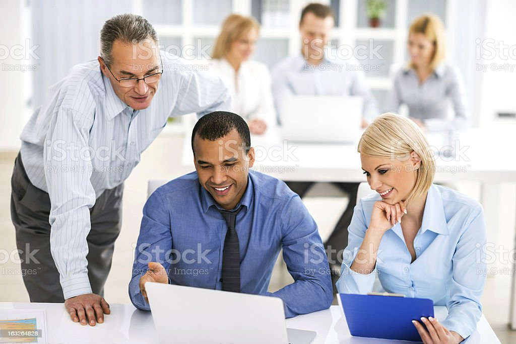 Boss working with his employees. royalty-free stock photo