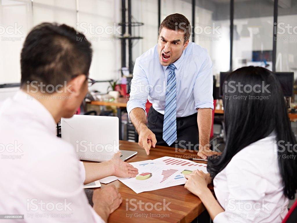 boss yelling at subordinates stock photo