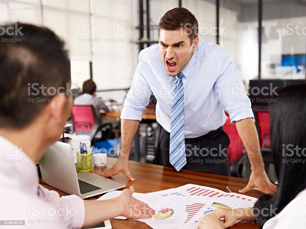 boss yelling at subordinates bildbanksfoto