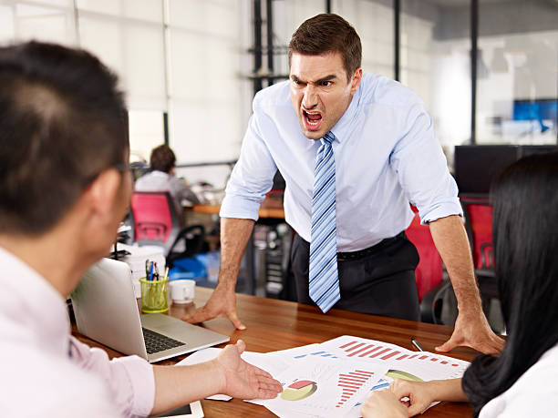 boss yelling at subordinates bad-tempered caucasian business executive yelling at two asian subordinates in office. agitation stock pictures, royalty-free photos & images