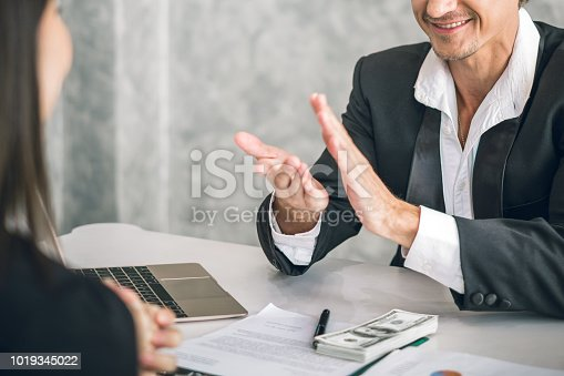 istock Boss/Business man employer admires young Asian business woman/staff/employee by thumb up and clap with smiling face for her success and good/best in work and recognition/appreciate. 1019345022