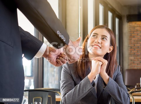 istock Boss/employer admires to young Asian businesswoman/staff/employee with smiling face for her success and good/best in work. 869694272