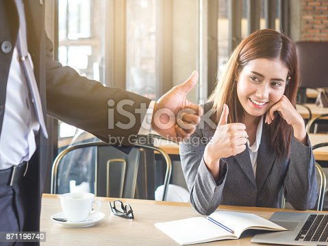 istock Boss/employer admires to young Asian businesswoman/staff/employee with smiling face for her success and good/best in work. 871196740