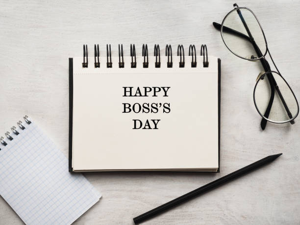 Boss's day. Greeting card. Close-up, view from above Happy Boss's day. Greeting card. Close-up, view from above, wooden surface. Concept of preparation for a professional holiday. Congratulations for relatives, friends and colleagues boss's day stock pictures, royalty-free photos & images