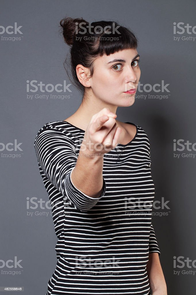 bossy 20s woman threatening someone with self-assertion stock photo