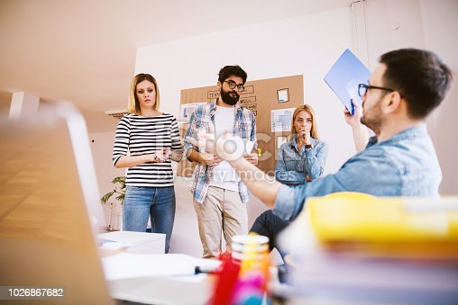 1018458132istockphoto Bossy businessman is giving a lecture to his colleges because they did not accomplished their work. 1026867682