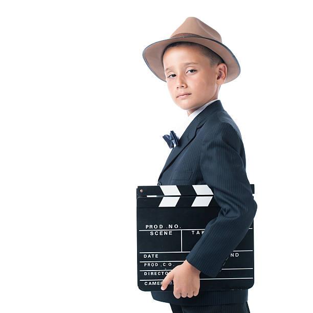 herrisch little director holding film slate - klappe hut stock-fotos und bilder