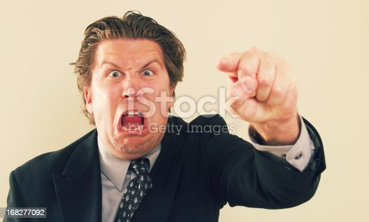 a bossy businessman pointing and screaming.