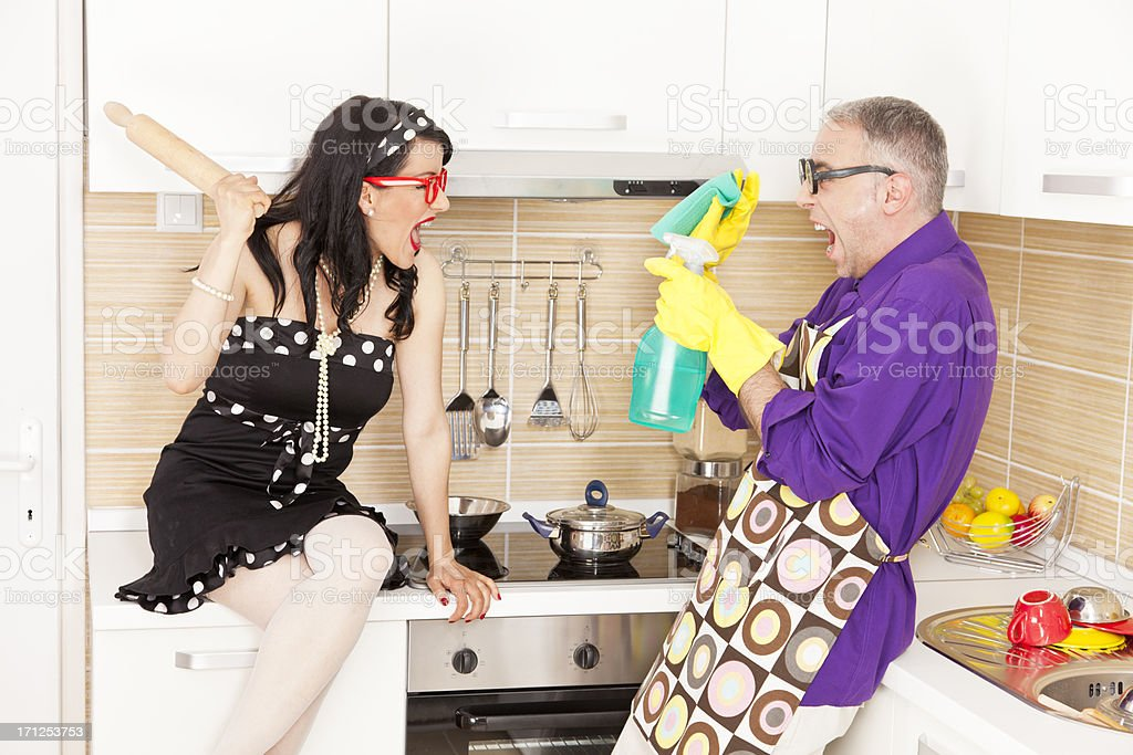 Bossy wife harassing her nerdy husband stock photo