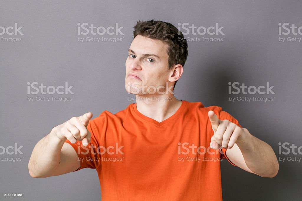 bossy young sporty man accusing or threatening someone stock photo