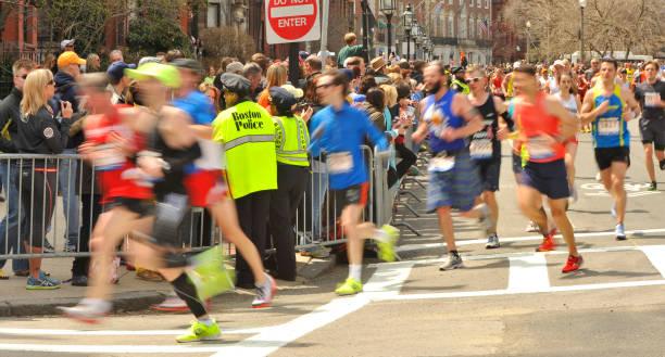 boston 2013 marathon runners @ mile 26 with boston police - boston marathon stock photos and pictures