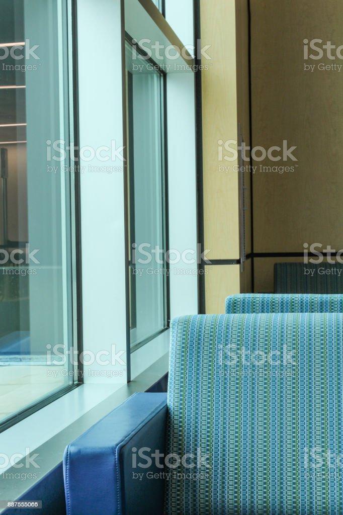 Boston airport terminal passenger seating beside windows, May 15 2017 stock photo