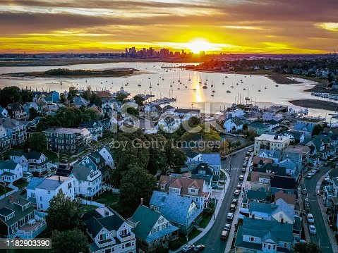This is an aerial view of Winthrop's. Waterfront looking at the Boston skyline during sunset
