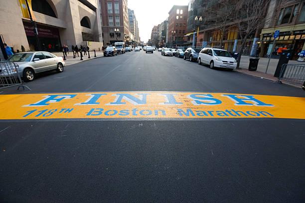 boston marathon finish line boylston street - boston marathon stock photos and pictures
