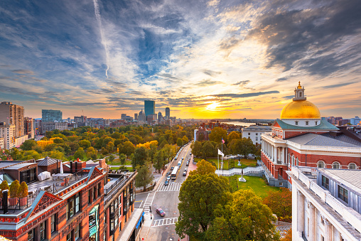 Boston, Massachusetts, USA cityscape with the State House at dusk.