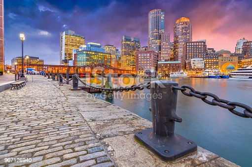 Boston, Massachusetts, USA harbor and cityscape at dusk.