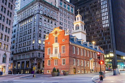 Boston, Massachusetts, at the USA Old State House and cityscape at dawn.