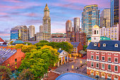 Boston, Massachusetts, USA skyline over Quincy Market and Faneuil Hall.