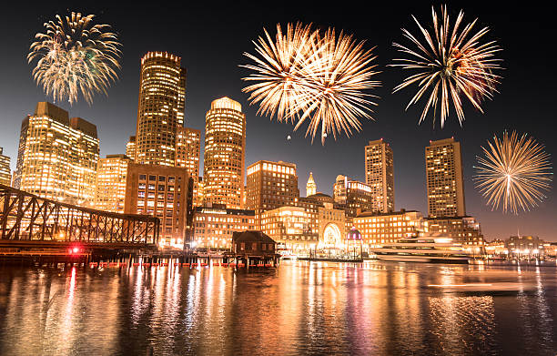 boston night skyline with fireworks for the 2017 stock photo