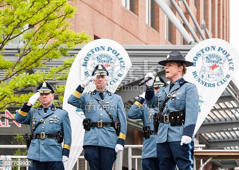 Boston Police singing and saluting to the star-spangled banner at Boston's Run to Remember May 29, 2016 at Boston's Seaworld Trade Center in Boston, MA.