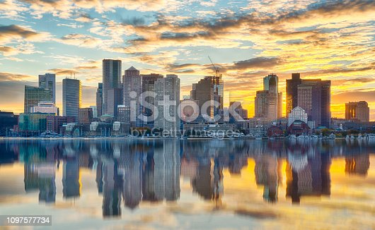 Boston skyline at sunset from across the harbor