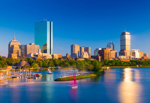 Boston skyline at the evening. Cityscape of Back Bay Boston. Skyscrapers and office buildings reflected in the water of Charles River stock photo