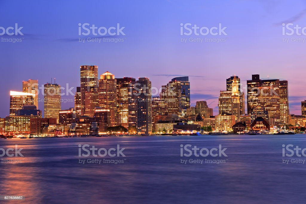 Boston skyline illuminated at night stock photo