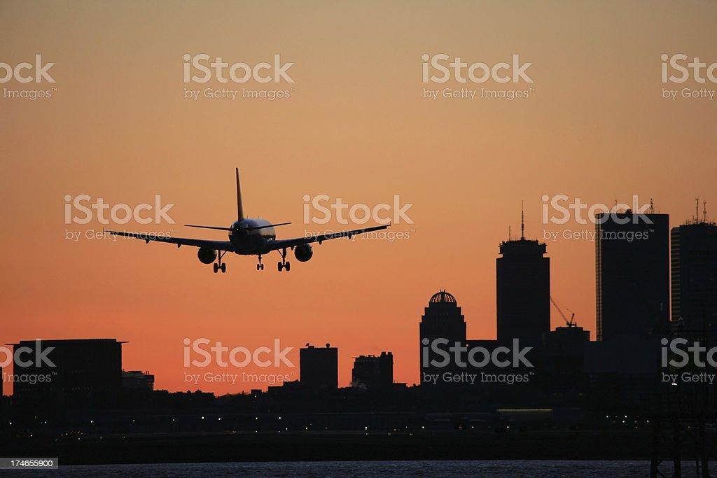 Boston Skyline Logan Airport Arrival Airliner Sunset stock photo