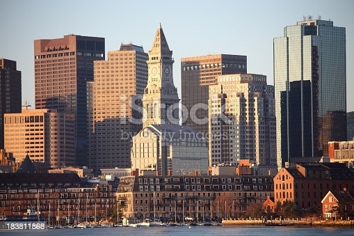 Boston skyline including the Custom House Tower as seen from across the Boston Harbor. Boston is the largest city in New England, the capital of the state of Massachusetts. Boston is known for its central role in American history,world-class educational institutions, cultural facilities, and champion sports franchises.