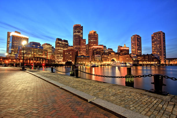 Boston Skyline with Financial District and Boston Harbor at Dusk stock photo